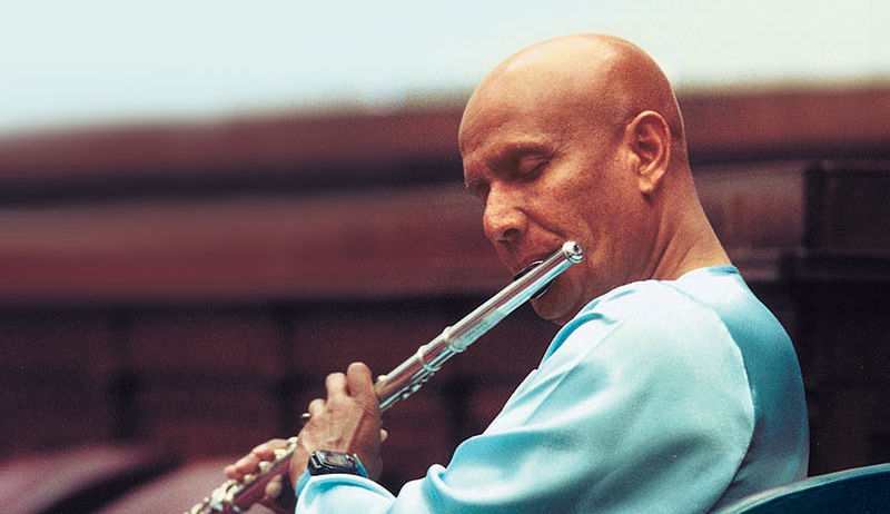 Sri Chinmoy plays flute